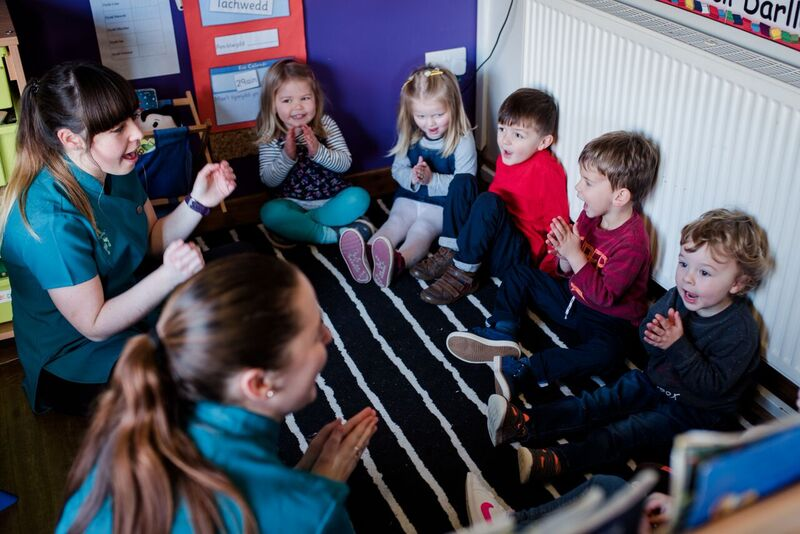 Group of children singing in a day nursery