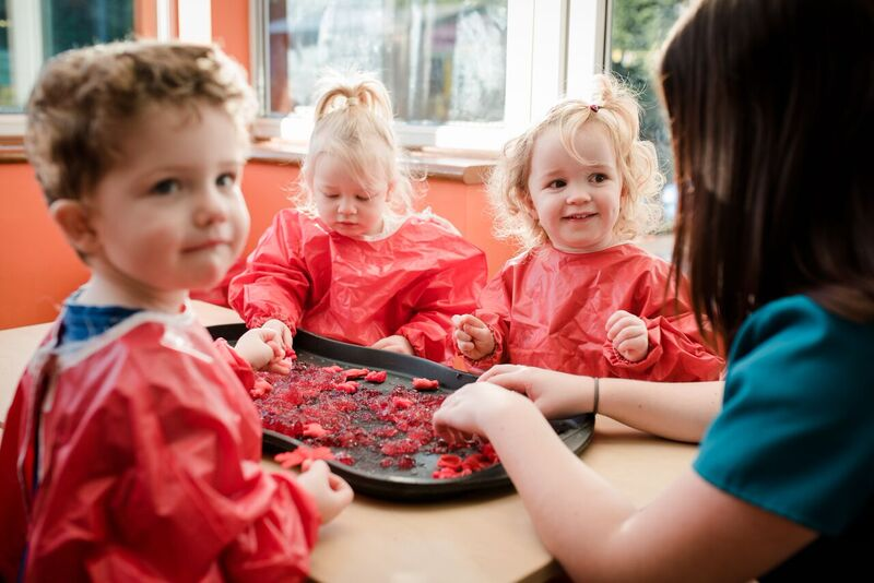 Children playing with jelly in nursery