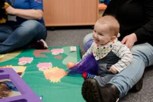 Baby playing in Flying Start Language and Play Session