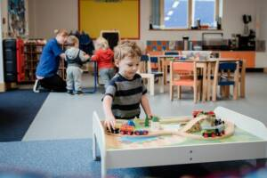Boy playing with train in afterschool club