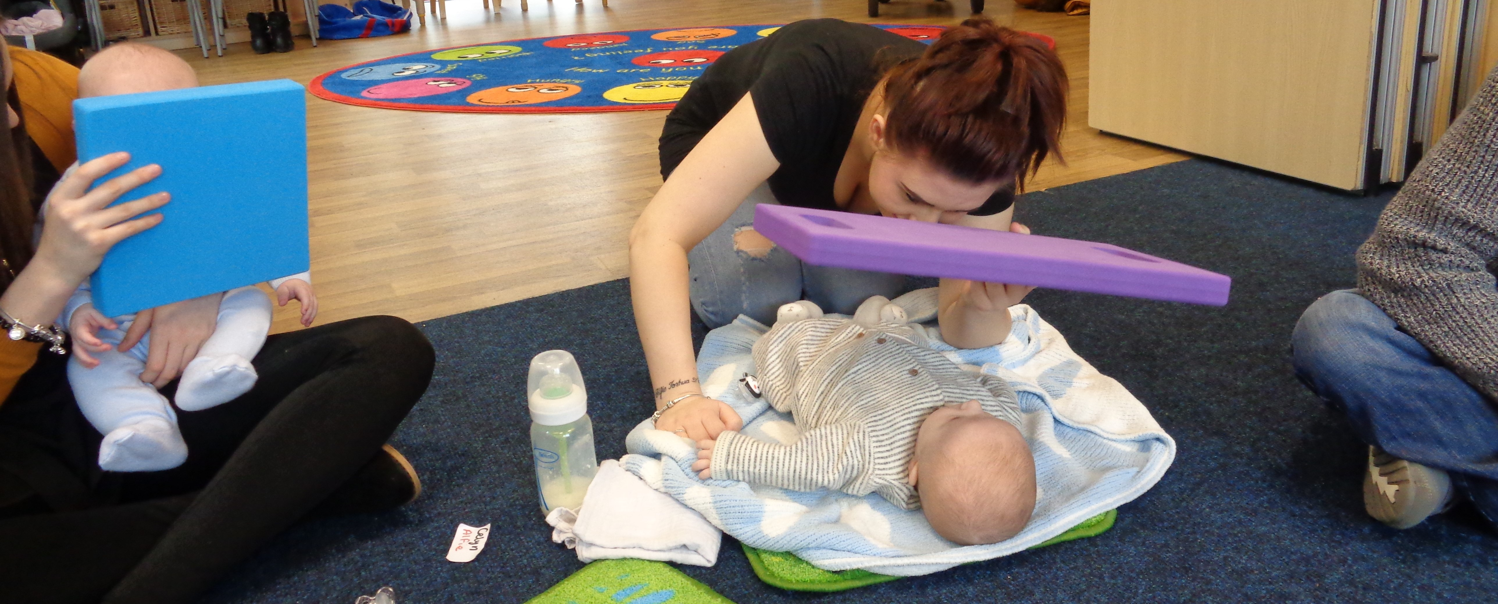 Baby playing with a mirror at baby babble