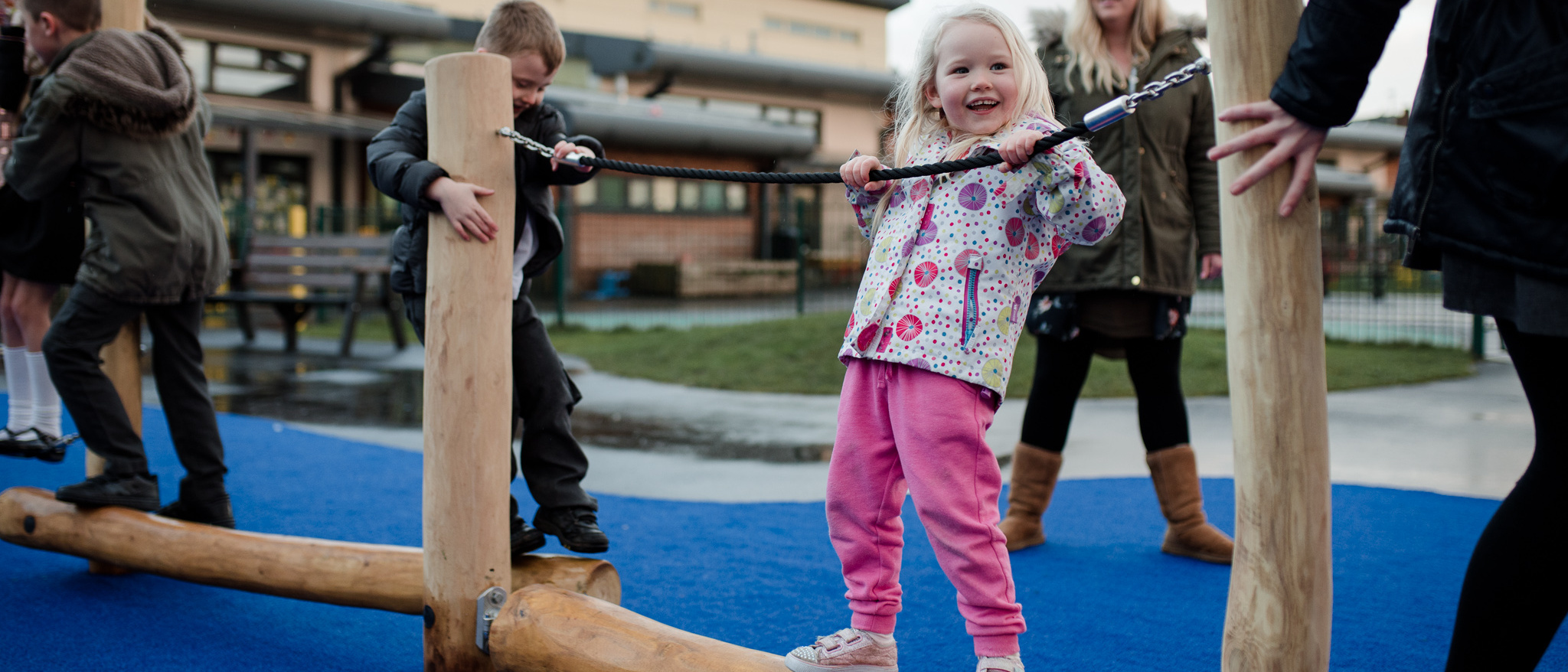 Children playing on rope climbing frame