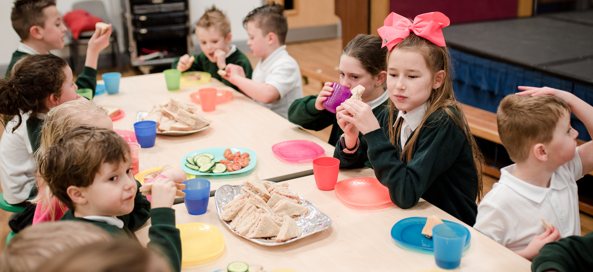 Children eating sandwiches in after school club