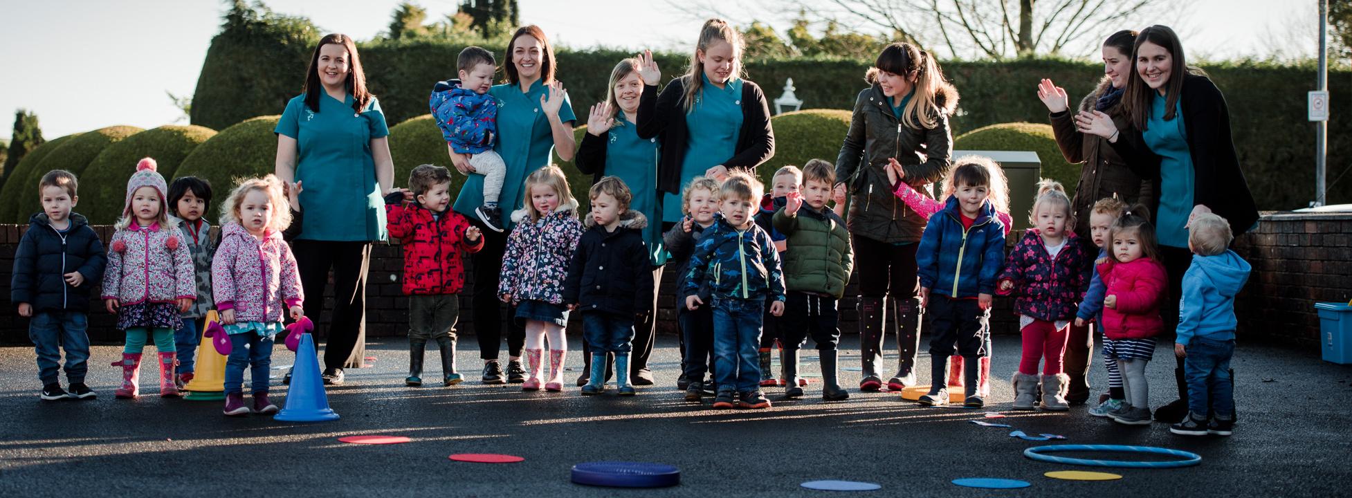 Y Cam Cynta Nursery children and staff in yard