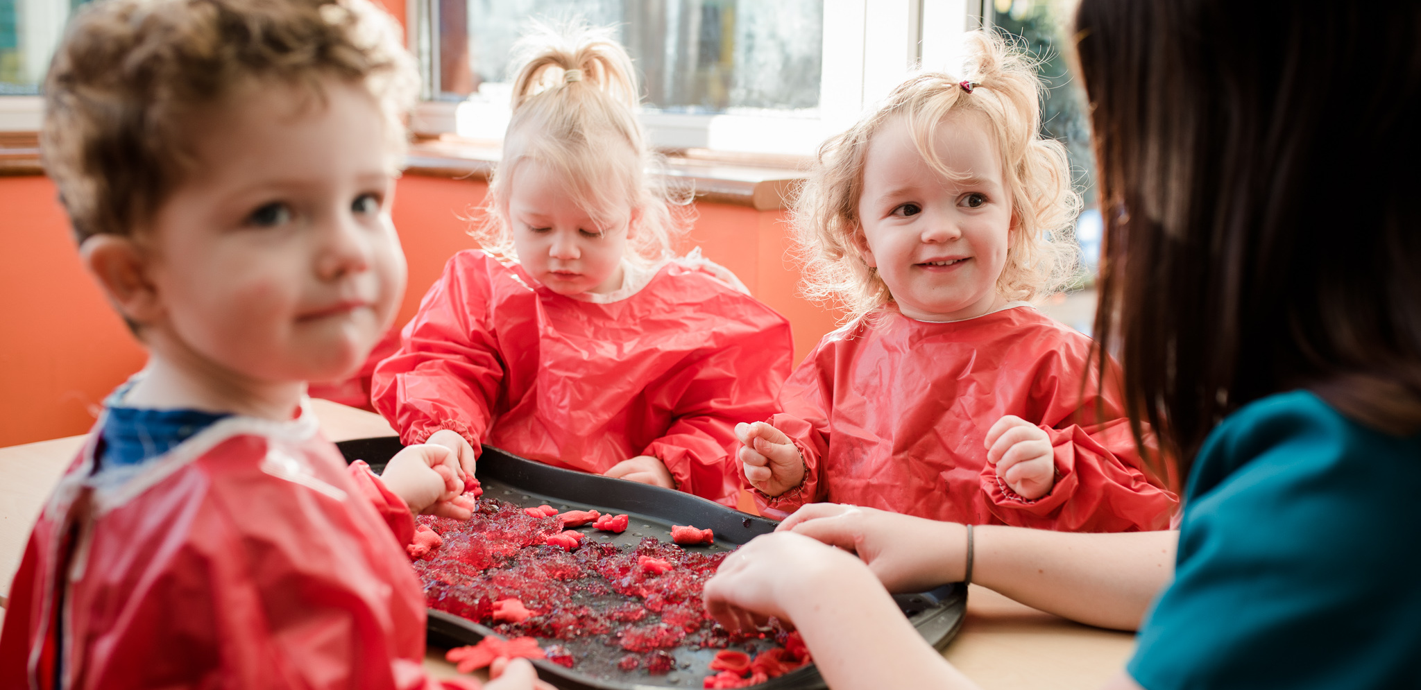 Children in aprons making food